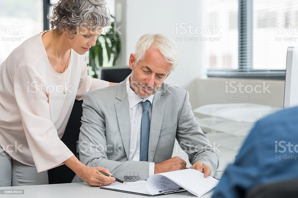 Mature business people working stock photo
