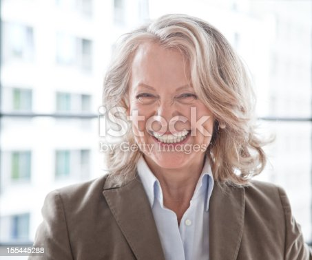 istock Mature business woman laughing 155445288