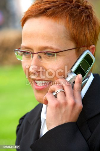 1150572074istockphoto Mature business woman making a phone call. 139903062
