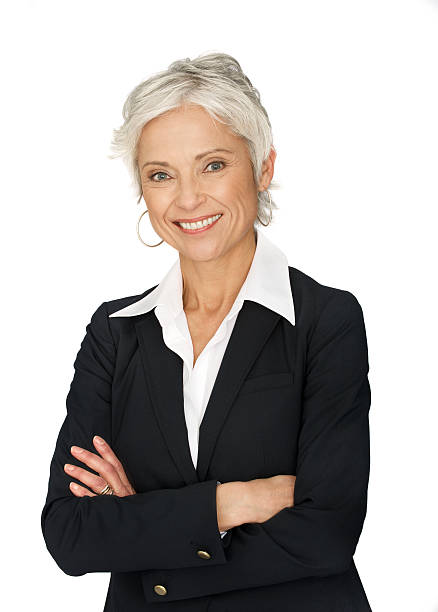 Mature business woman on white background. stock photo
