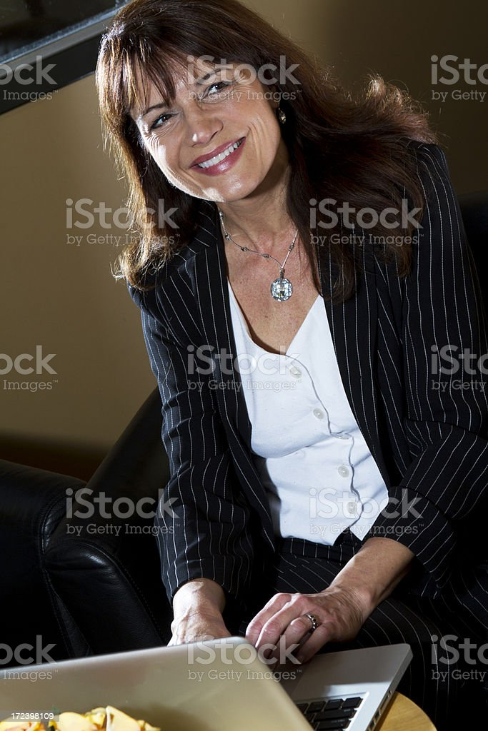 Mature business woman smiles royalty-free stock photo