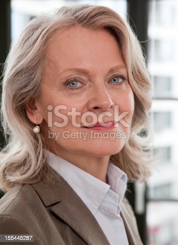 istock Mature business woman smiling 155445287