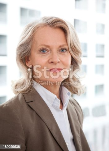 istock Mature business woman smiling 182059508