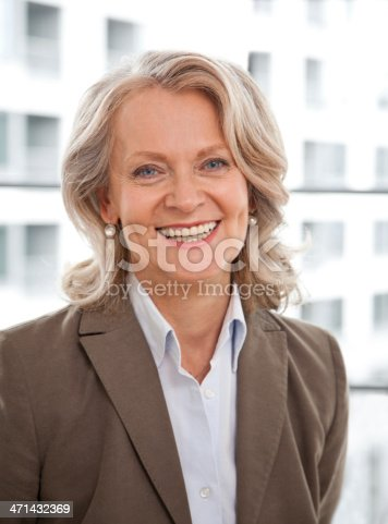 istock Mature business woman smiling 471432369