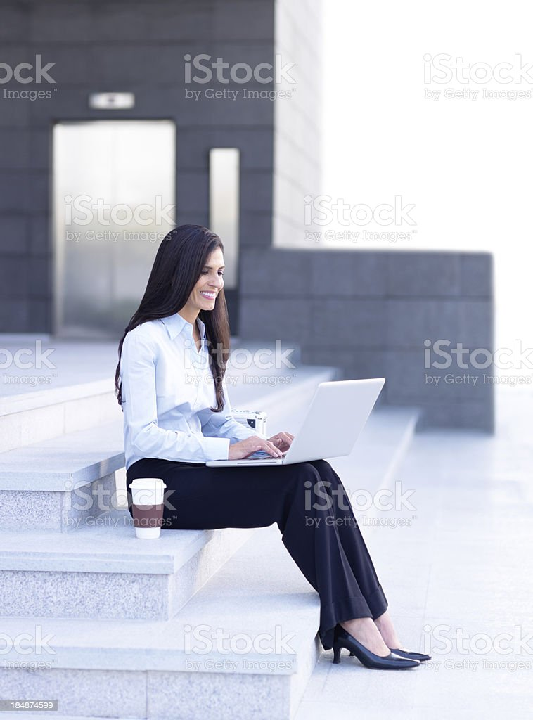 Mature business woman working on laptop royalty-free stock photo