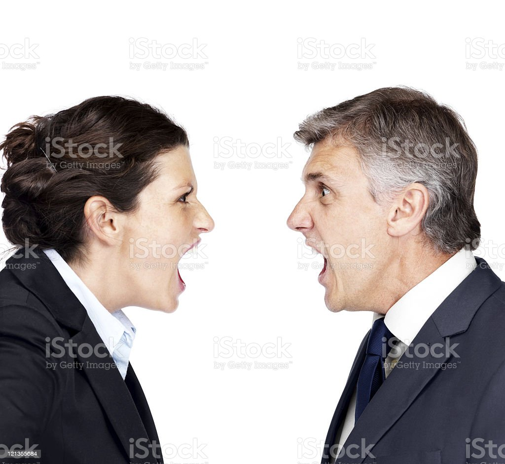 Mature businessman and woman yelling at each other royalty-free stock photo