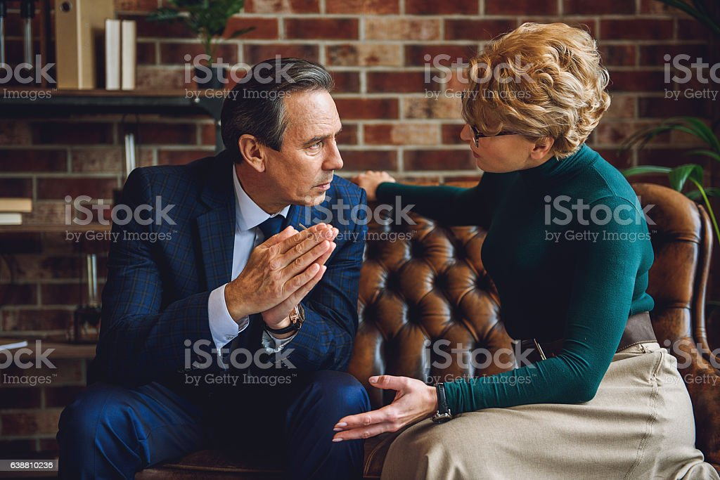 Mature businessman asking for psychic help stock photo