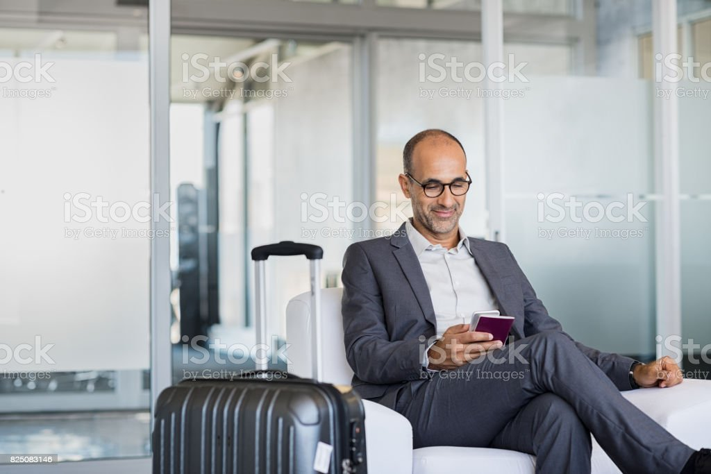 Mature businessman at airport stock photo