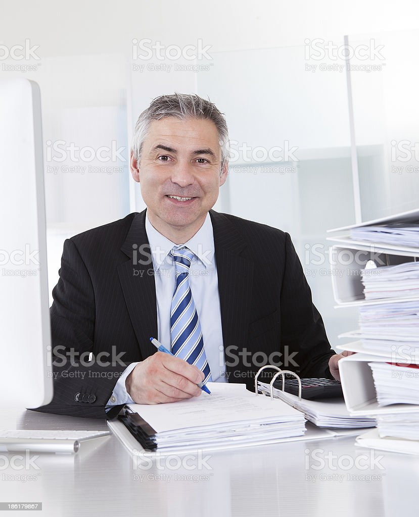 Mature Businessman At Work royalty-free stock photo