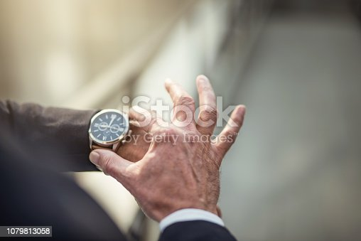 Mature businessman checking time hand close up.