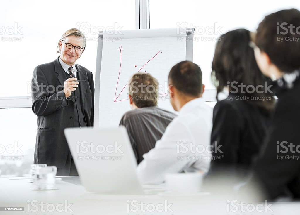 Mature businessman drawing a graph. royalty-free stock photo