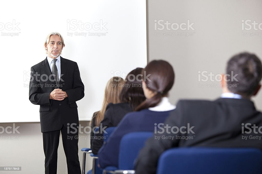 Mature businessman giving business training royalty-free stock photo