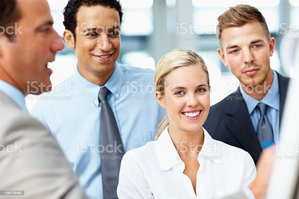 Mature businessman giving presentation to young executives royalty-free stock photo