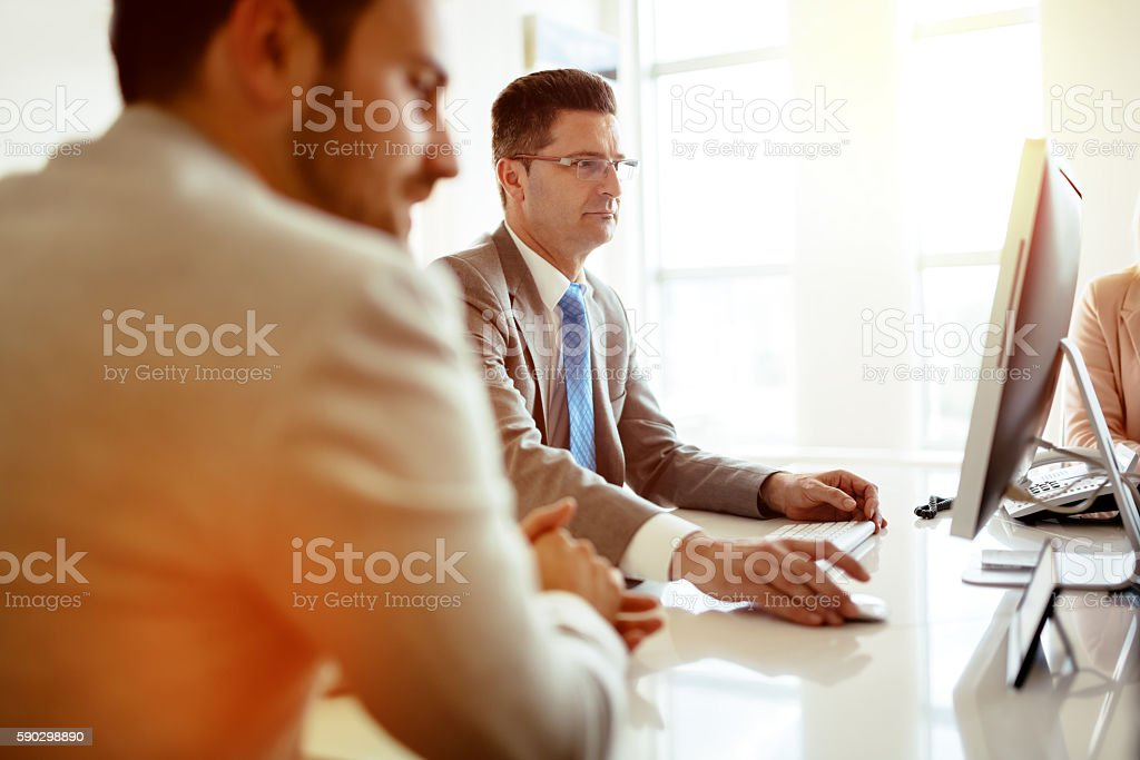 Mature businessman holding a meeting royaltyfri bildbanksbilder