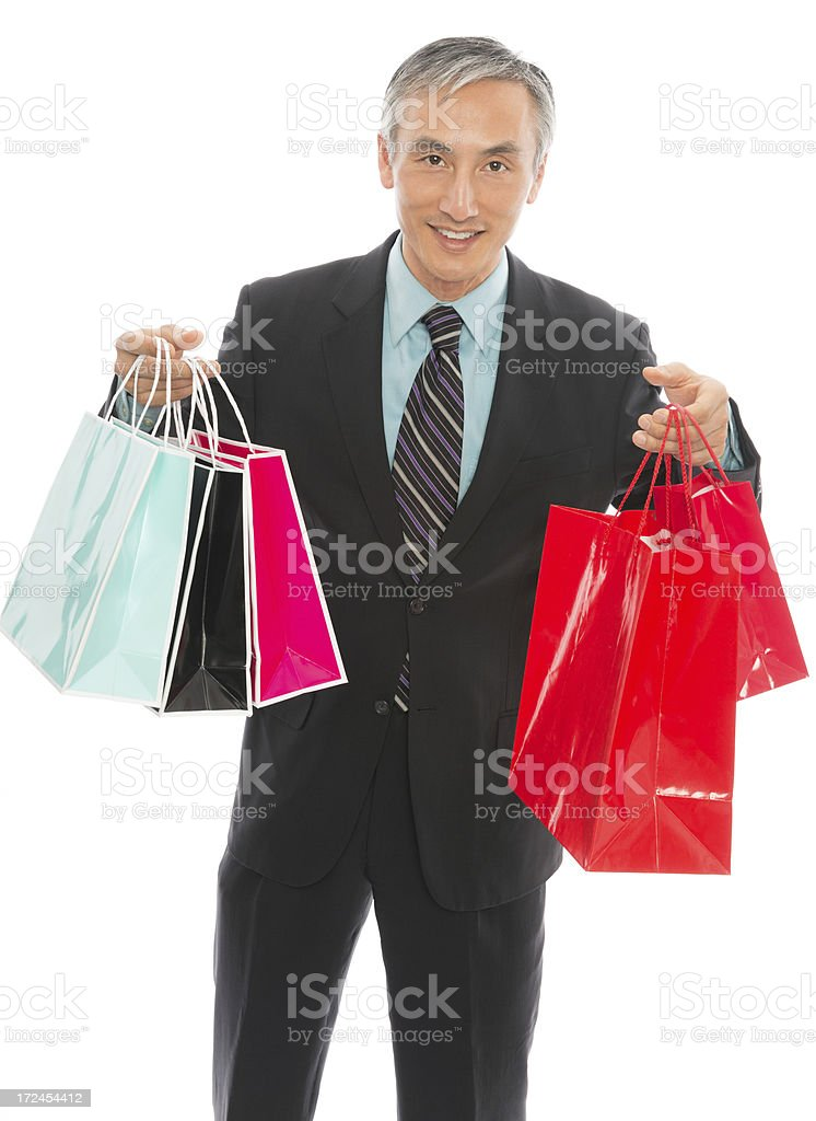 Mature Businessman Holding Shopping Bags royalty-free stock photo