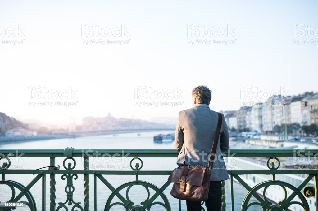 Mature businessman in a city. stock photo