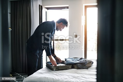 istock Mature businessman in a hotel room. 878985948