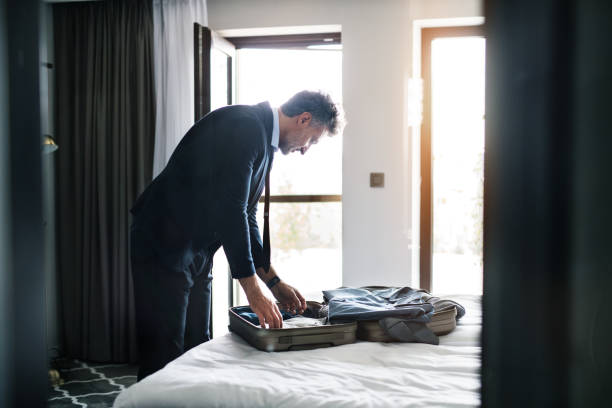 Mature businessman in a hotel room. stock photo