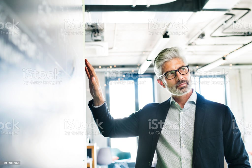 Mature businessman in suit in the office. royalty-free stock photo