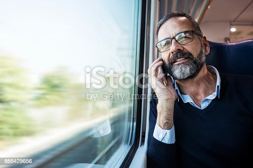 istock Mature businessman in train 885429656