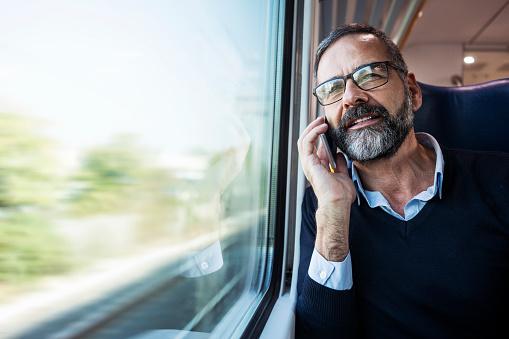 istock Mature businessman in train 885429656