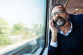 Mature businessman in train