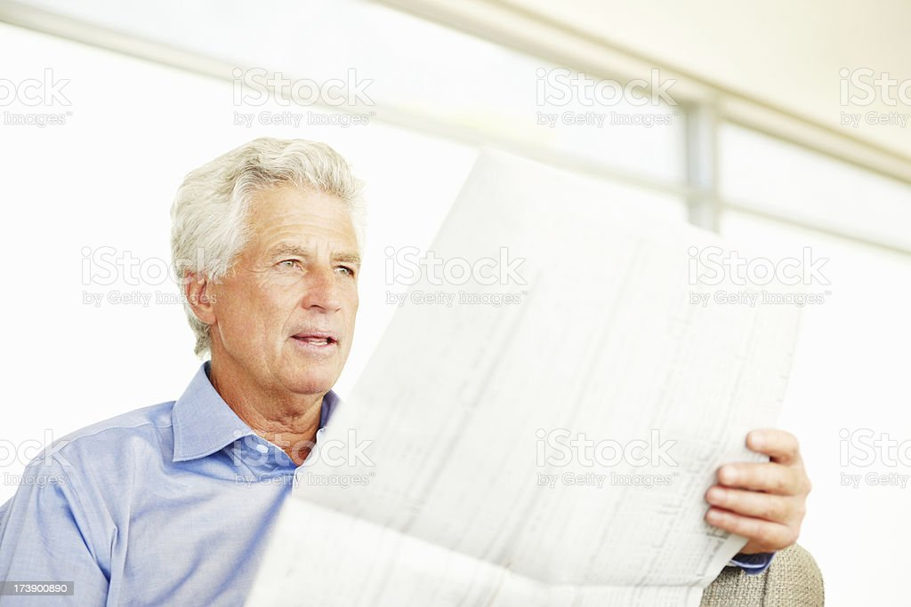 Mature businessman reading newspaper royalty-free stock photo