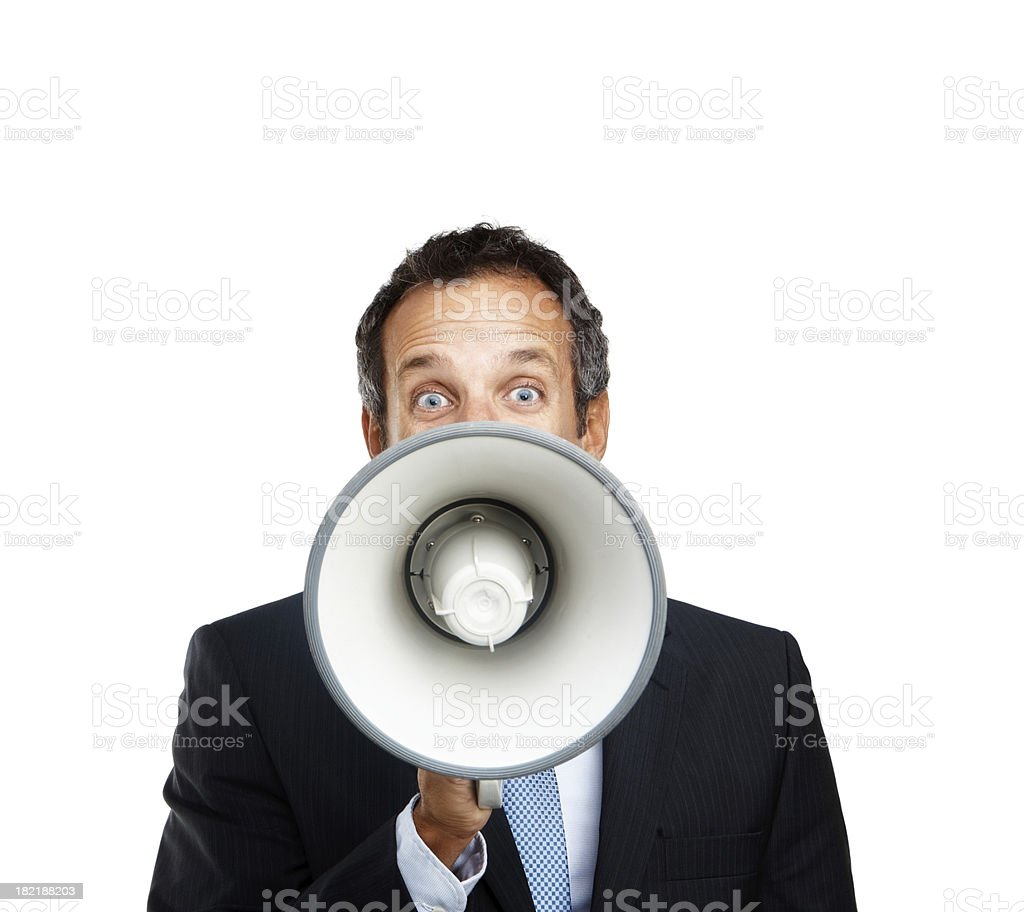 Mature businessman shouting into a megaphone royalty-free stock photo