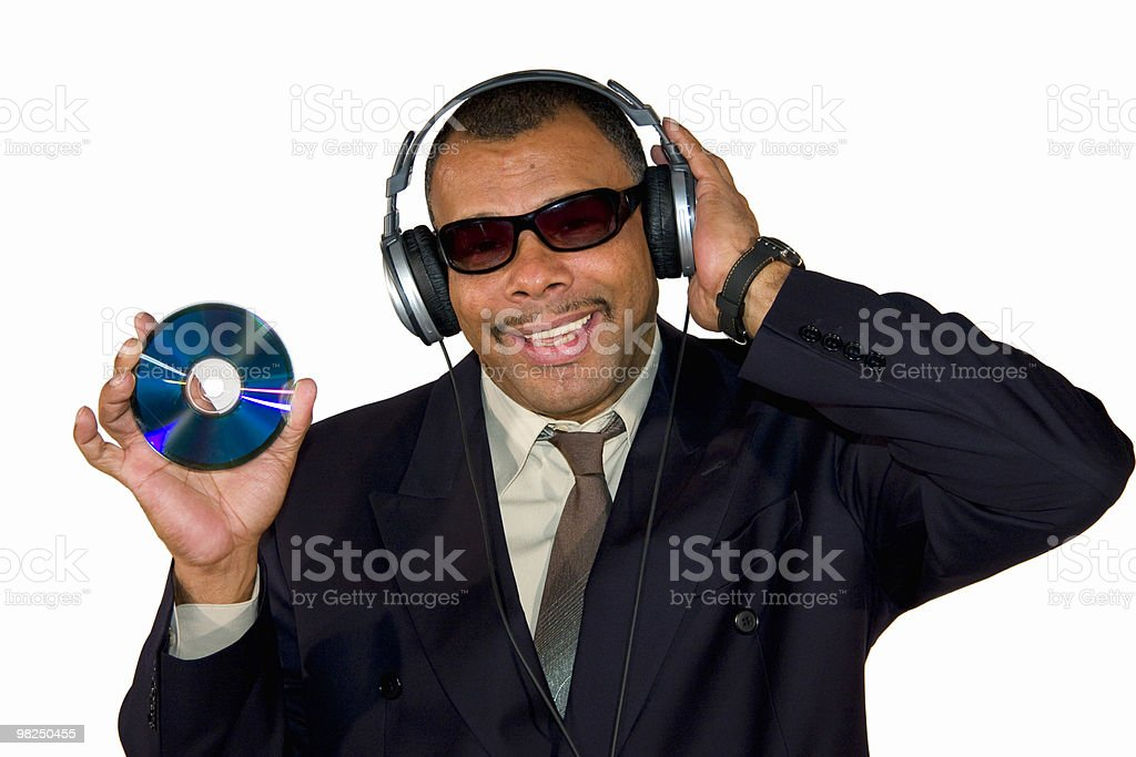 mature businessman showing an audio CD royalty-free stock photo