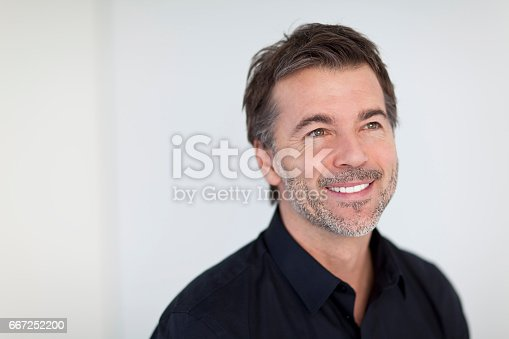 637538262istockphoto Mature Businessman Smiling and Looking Away. Isolated On White 667252200