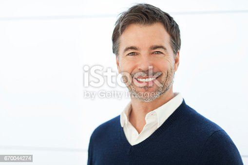 637538262istockphoto Mature Businessman Smiling At The Camera. Isolated On White. 670044274