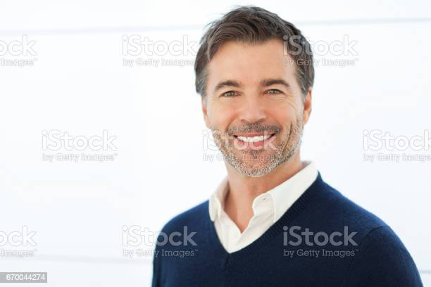 Mature Businessman Smiling At The Camera Isolated On White Stock Photo - Download Image Now