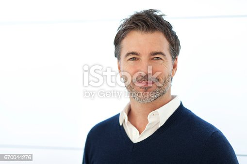 637538262istockphoto Mature Businessman Smiling At The Camera. Isolated On White. 670044276