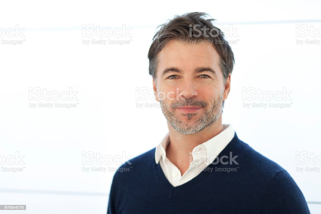 Mature Businessman Smiling At The Camera. Isolated On White. stock photo