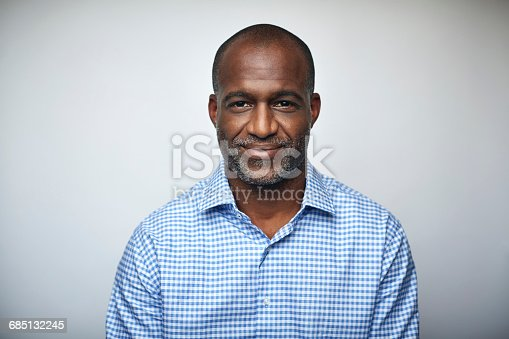 istock Mature businessman smiling over white background 685132245