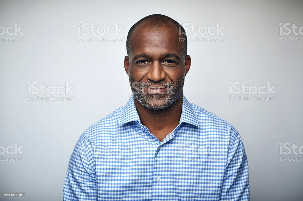 Mature businessman smiling over white background stock photo