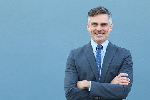 istock Mature businessman smiling wearing classic suit 645075706