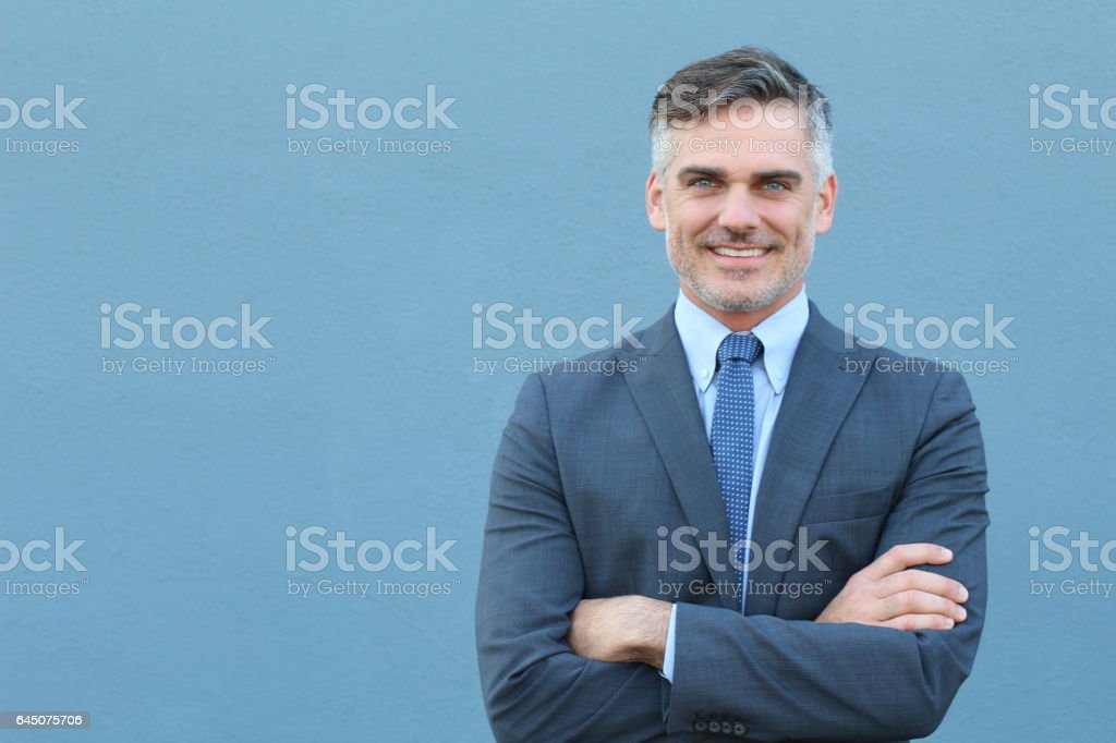 Mature businessman smiling wearing classic suit stock photo