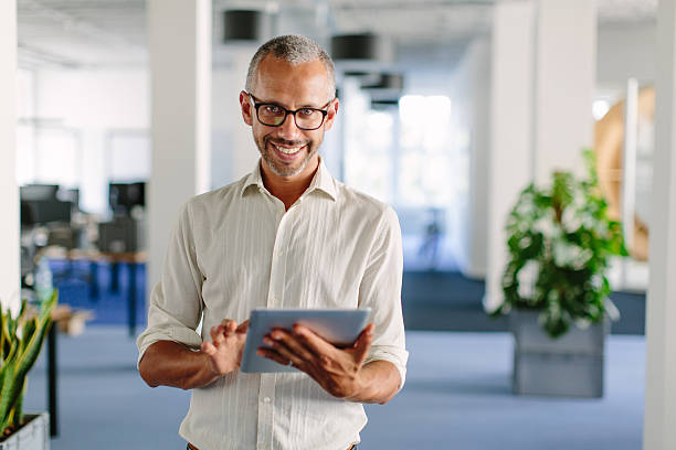 Mature businessman smiling with digital tablet in office picture id618761244?b=1&k=6&m=618761244&s=612x612&w=0&h=hmeuzy2sbveli8tgslvdtunxhqenakxukq06pkkeore=