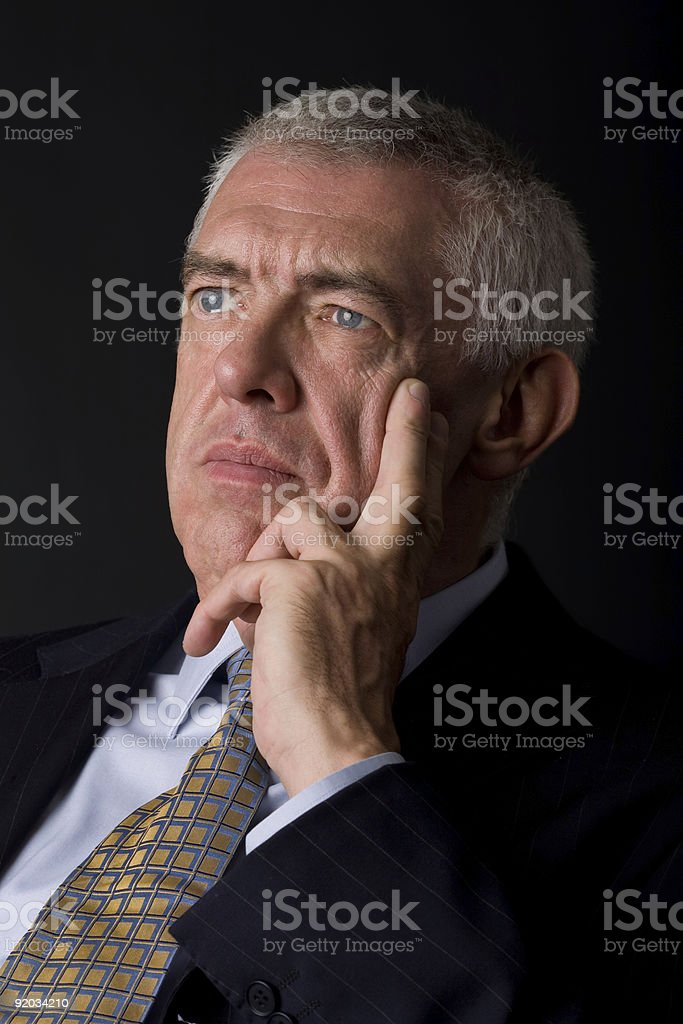 mature businessman thinking royalty-free stock photo