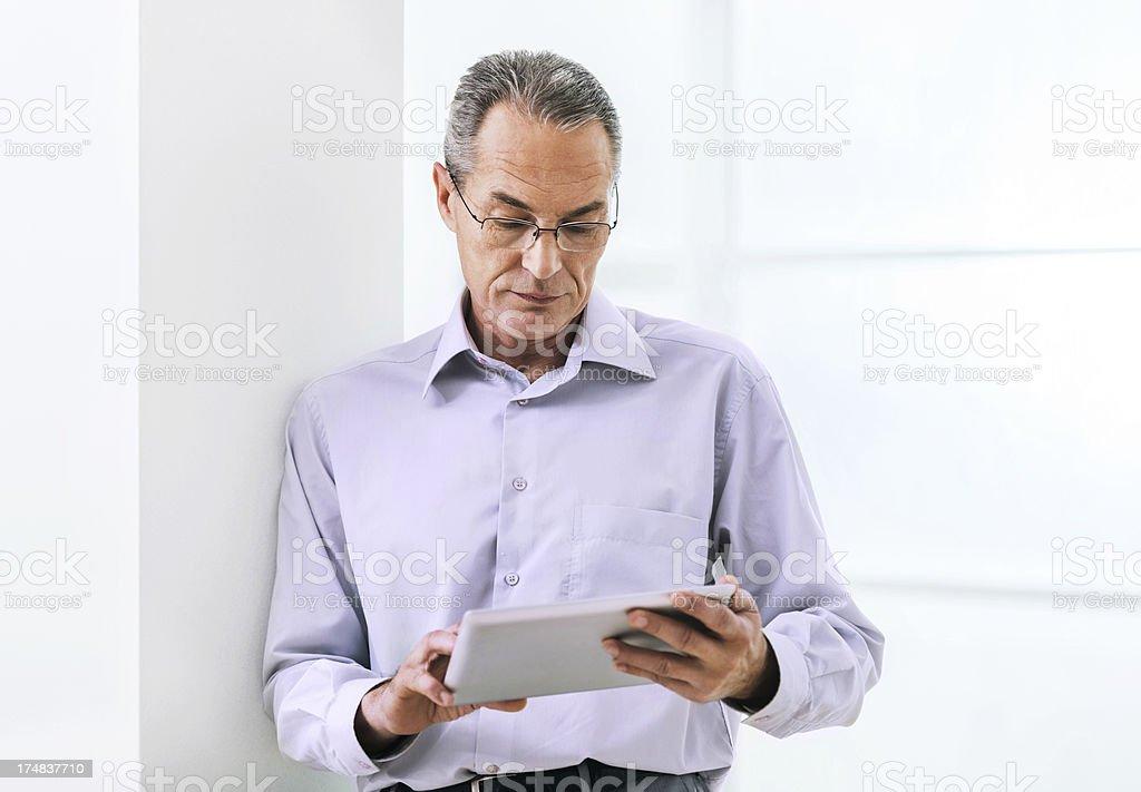 Mature businessman using digital tablet. royalty-free stock photo