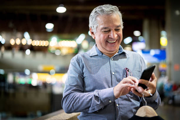 Mature Businessman Using Mobile Phone at Airport stock photo