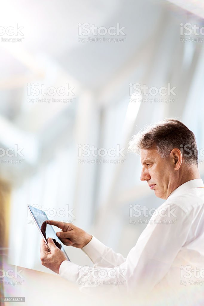 Mature businessman using touchpad. royalty-free stock photo