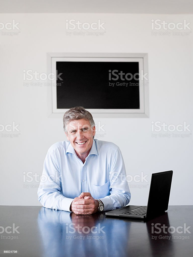 Mature businessman with a laptop computer royalty-free stock photo