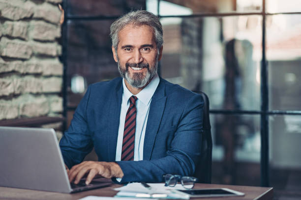 Mature businessman with a laptop stock photo