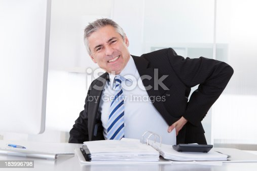 821012164istockphoto Mature Businessman With Back Pain 183996798