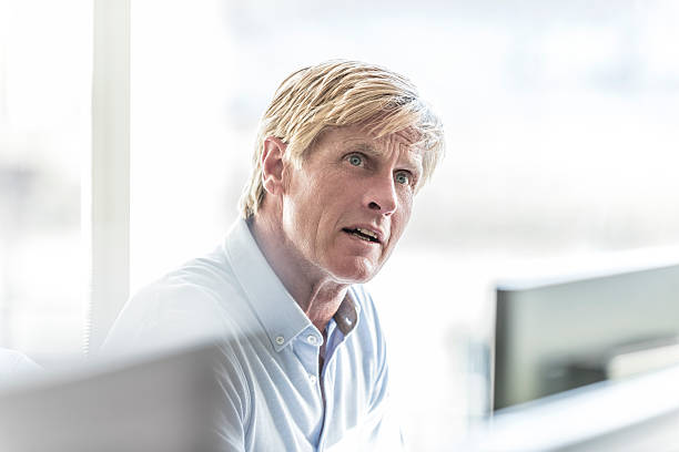 Mature businessman with blonde hair in office looking away picture id496445352?b=1&k=6&m=496445352&s=612x612&w=0&h=oav1zwahdjpkwu0zcz8wo3my yjlfj39elo5ebgdgnu=