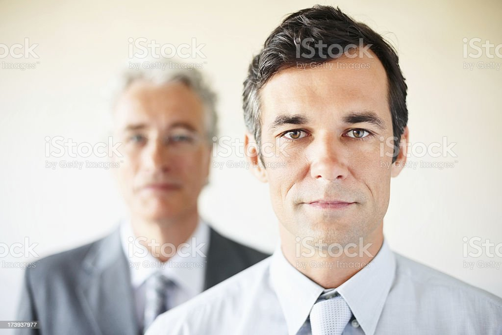 Mature businessman with his colleague in background royalty-free stock photo