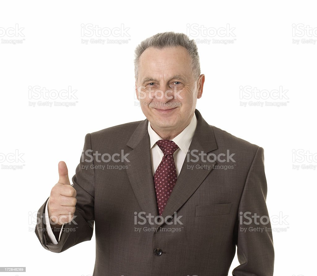 mature businessman with thumb up royalty-free stock photo