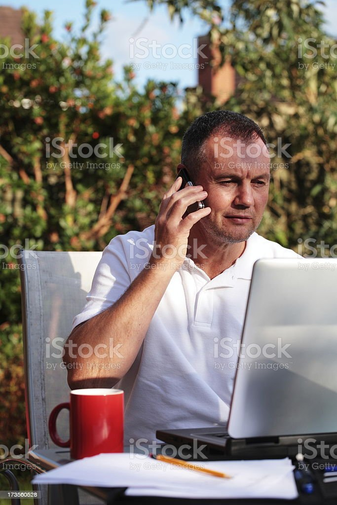 Mature Businessman Works From Home royalty-free stock photo